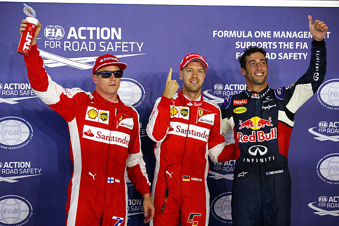 Ferrari's Vettel takes pole in Singapore, ends Mercedes' reign
