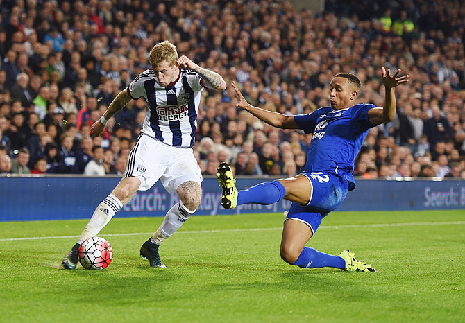 West Bromwich Albion's James McClean is blocked by Everton's Brendan Galloway
