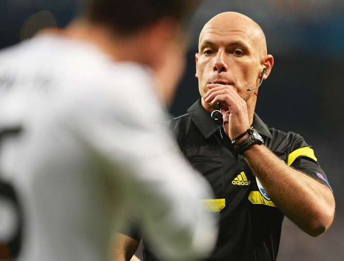 Referee Howard Webb blows his whistle