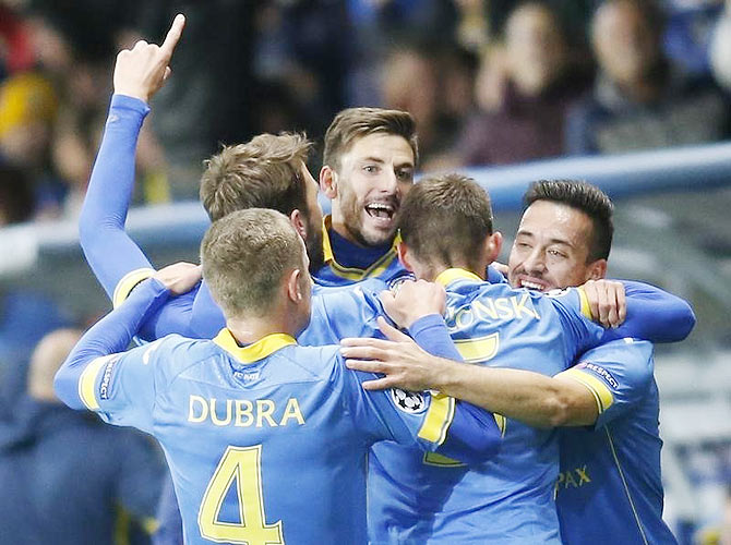BATE Borisov's Filip Mladenovic (centre) celebrates with teammates after scoring against AS Roma during their Champions League Group E match at the Borisov Arena outside Minsk, in Belarus on Tuesday