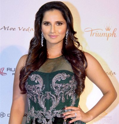 Rediff Sports - Cricket, Indian hockey, Tennis, Football, Chess, Golf - Sania Mirza turns up as jury at Femina Miss India