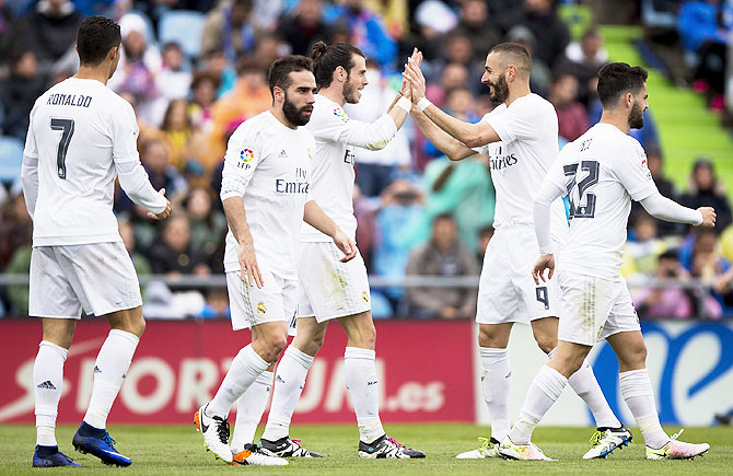 Rediff Sports - Cricket, Indian hockey, Tennis, Football, Chess, Golf - Who will score Real Madrid's 100th goal of the season?