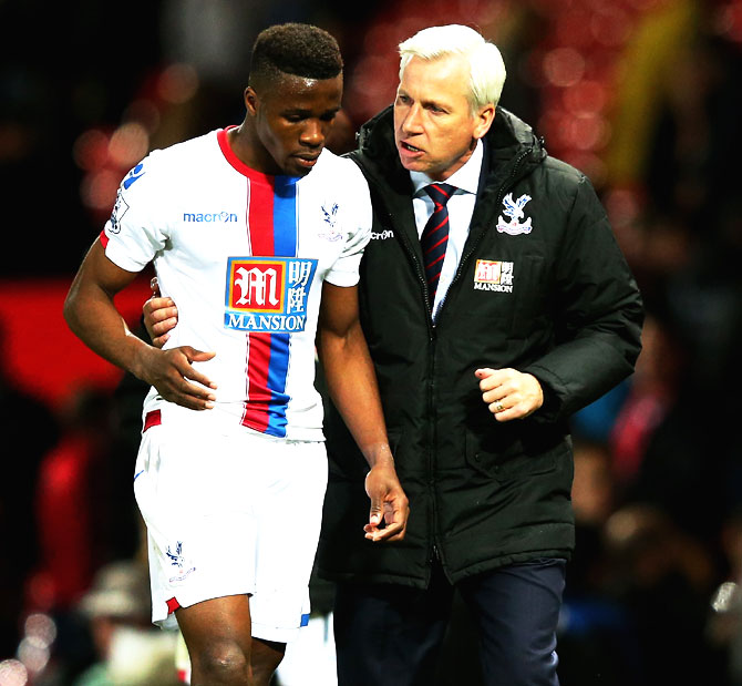 Crystal Palace's Wilfried Zaha and manager Alan Pardew in conversation