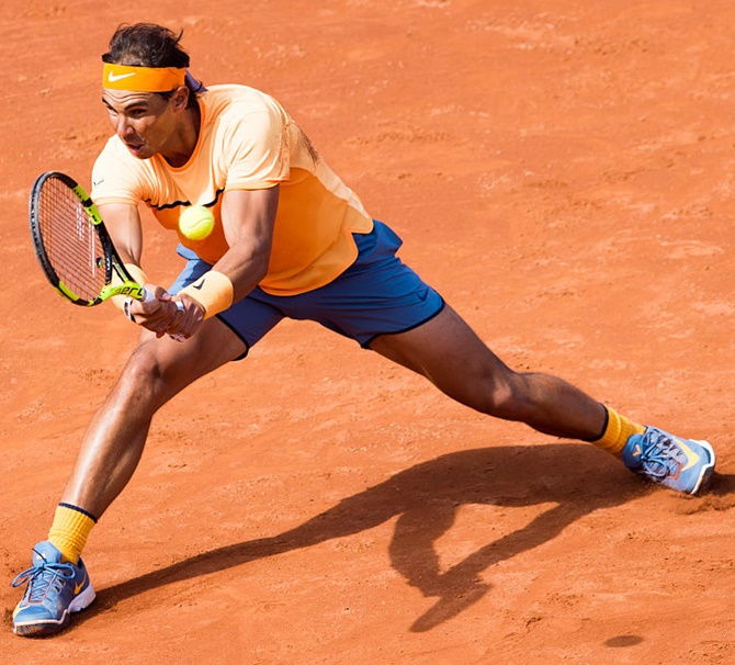 Rediff Sports - Cricket, Indian hockey, Tennis, Football, Chess, Golf - Barcelona Open: Nadal sees off troublesome Fognini