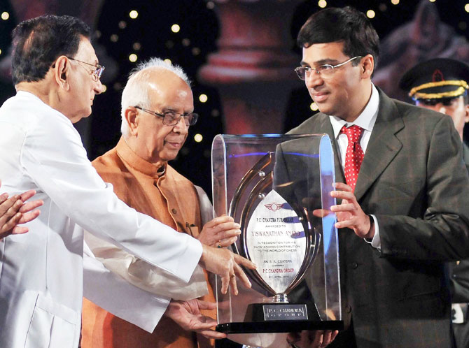 Former World Chess Champion Grand Master Viswanathan Anand felicitated with the P C Chandra Puraskar for his excellent contribution in the field of world sport by West Bengal Governor Keshari Nath Tripathi, while B K Chandra (left), Charman, PC Chandra Group looks on in Kolkata on Sunday