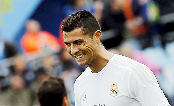 Rediff Sports - Cricket, Indian hockey, Tennis, Football, Chess, Golf - Fit Ronaldo to travel with Real for Champions League semi-final tie