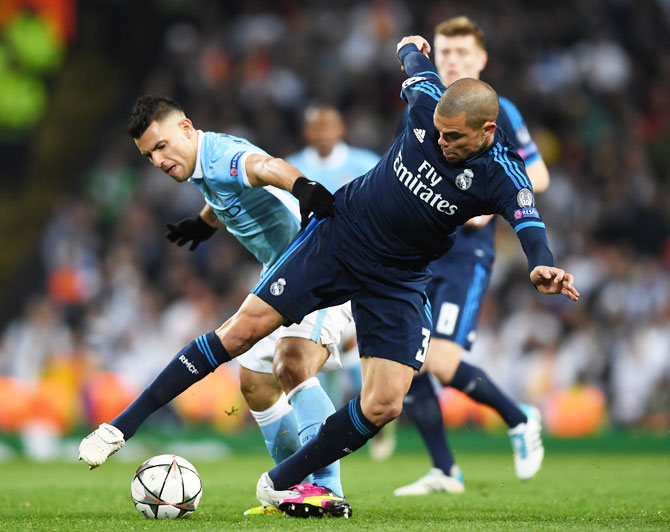 Rediff Sports - Cricket, Indian hockey, Tennis, Football, Chess, Golf - Champions League PIX: Manchester City hold Ronaldo-less Real