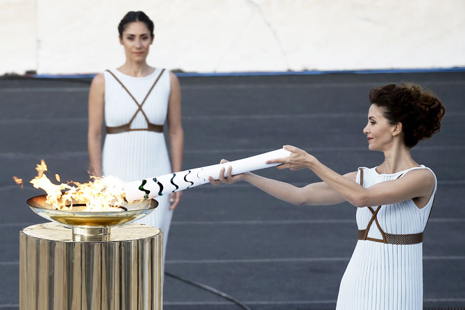 Rediff Sports - Cricket, Indian hockey, Tennis, Football, Chess, Golf - Host nation Brazil receives Olympic flame for Rio Games