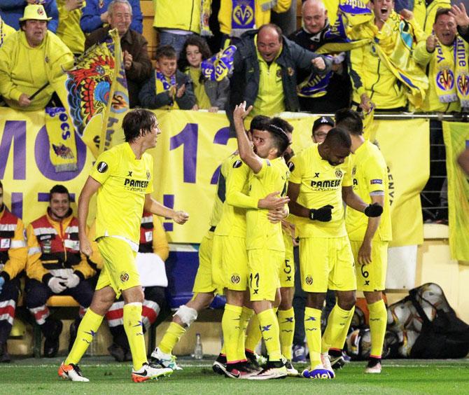 Rediff Sports - Cricket, Indian hockey, Tennis, Football, Chess, Golf - Europa League semis: Villarreal jolt Liverpool late, Sevilla held