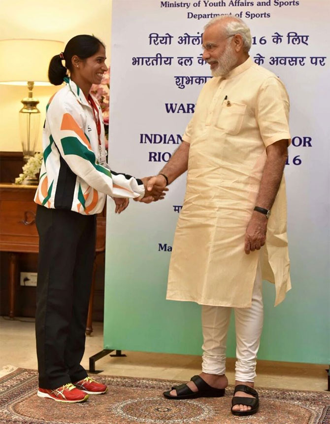 Prime Minister Narendra Modi wishes Sudha Singh at the send-off ceremony organised for the Indian contingent for Rio Olympics 2016 on July 4