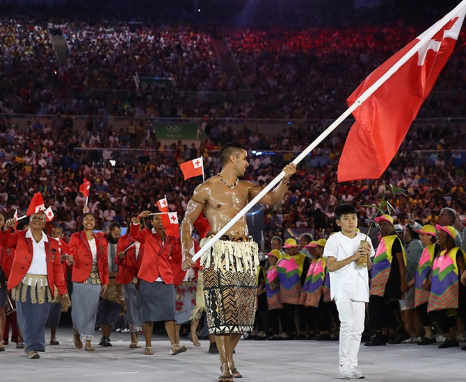 Pita Nikolas Aufatofua of Tonga carries the flag during the Opening Ceremony