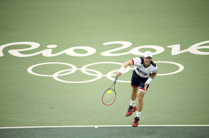 Great Britain's Andy Murray in action against Serbia's Viktor Troicki during their men's singles first round match at the Rio 2016 Summer Olympics on Sunday