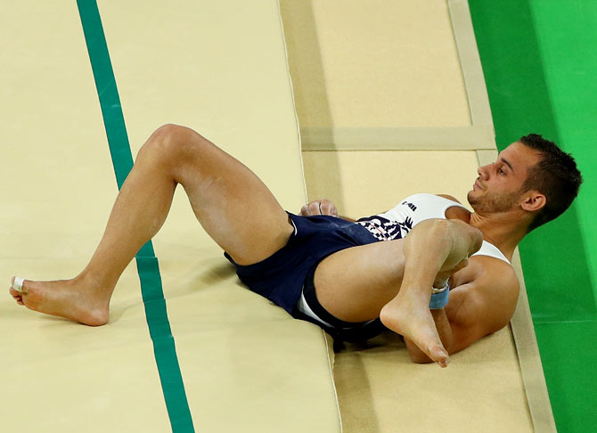 Samir Ait Said of France breaks his leg while competing on the vault during the Artistic Gymnastics Men's Team qualification at the Rio 2016 Olympic Games on August 6