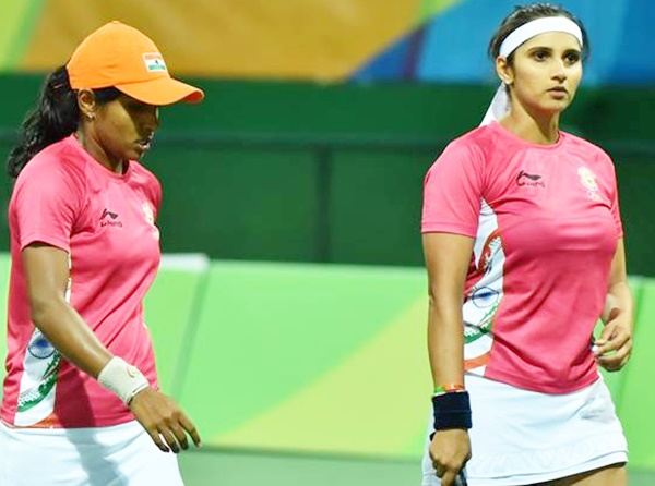 Rediff Sports - Cricket, Indian hockey, Tennis, Football, Chess, Golf - Sania-Prarthana go down fighting to Zhang-Peng