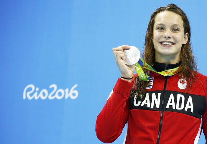 Canada's Penelope Oleksiak poses with her medal in the Women's 100m Butterfly Victory Ceremony in the Olympic Aquatics Stadium in Rio de Janeiro on Sunday