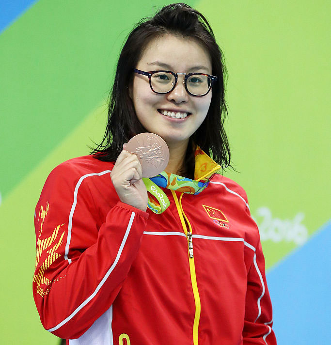 Bronze medalist Yuanhui Fu of China on the podium during the medal ceremony for the Women's 100m backstroke final on Monday