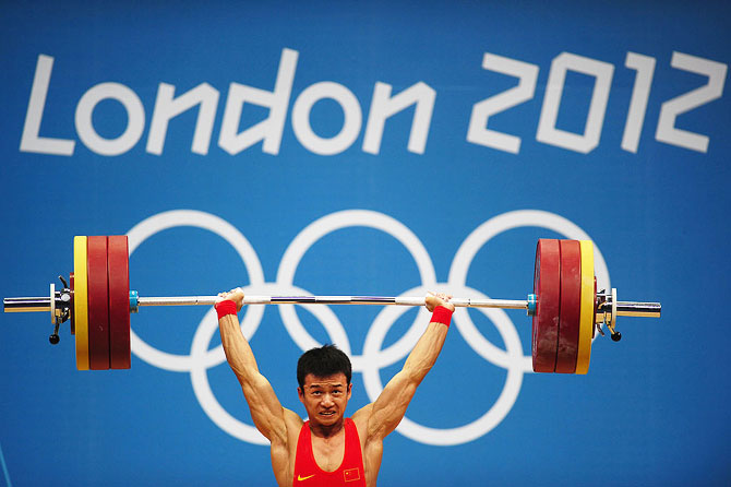 Jingbiao Wu of China competes in the Men's 56kg Weightlifting at the London 2012 Olympic Games