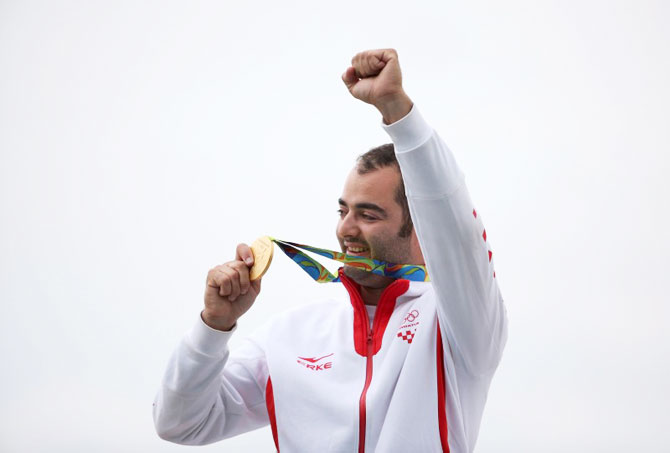 Josip Glasnovic of Croatia celebrates after taking gold in the Men's Trap shooting event at the Olympic Shooting Centre