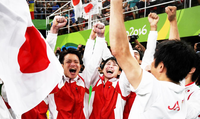 Japan gymnasts celebrate winning the men's team Artistic Gymnastics final on Monday