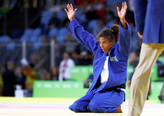 Brazil's Rafaela Silva celebrates after her gold medal win in the 57 kg Judo final on Monday