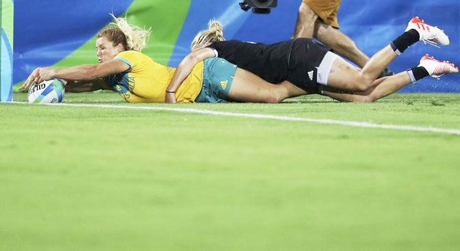 Australia's Emma Tonegato scores a try during the Rugby sevens gold medal match against New Zealand on Monday