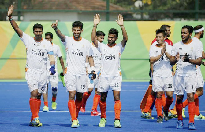 India hockey players celebrate their win over Argentina on Tuesday