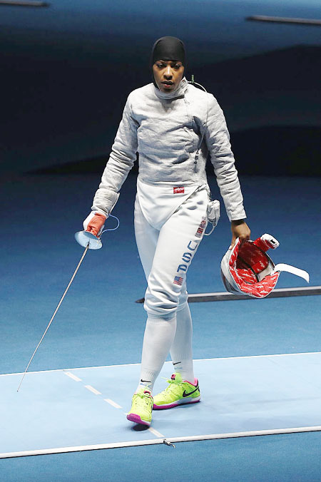 Ibtihaj Muhammad of the United States look dejected after losing to France's Cecilia Berder during the women's Individual Sabre on August 8