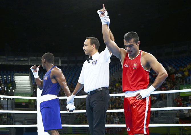 India's Vikas Krishan reacts after winning his bout against USA's Charles Conwell during their preliminary 75kg (middleweight) Round of 32 bout at Riocentro, Pavilion 6 in Rio de Janeiro on Tuesday