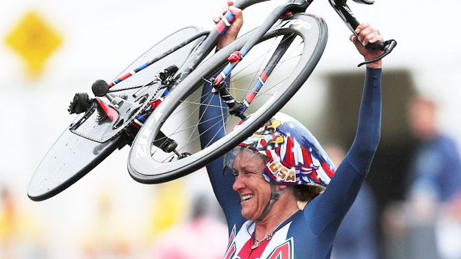 Kristin Armstrong celebrates after winning the Cycling Road Women's Individual Time Trial on August 10