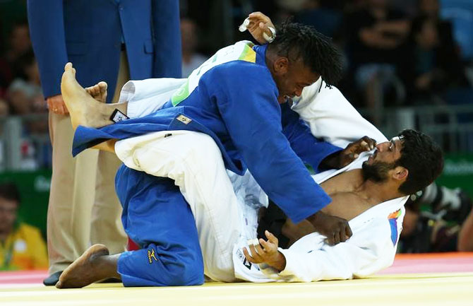 India's Avtar Singh and Refugee Olympic Athletes Popole Misenga compete during their men 90 kg Elimination Rounds at Carioca Arena 2 in Rio de Janeiro on Wednesday