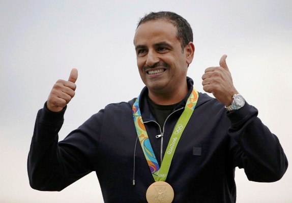 Fehaid Aldeehani of Independent Olympic Athlete poses with his men's double trap gold medal.