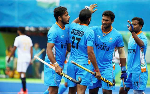 Akashdeep Singh of India (centre) celebrates with his teammates