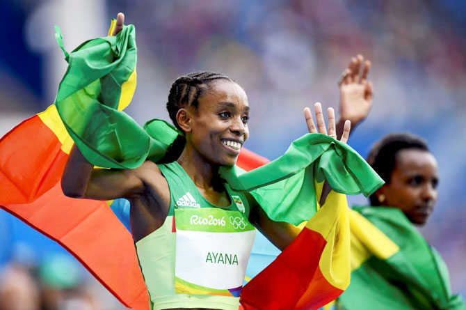 Ethiopia's Almaz Ayana celebrates after winning the Women's 10,000m Final at the Rio Olympics in Rio de Janeiro