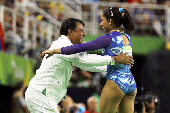 Dipa Karmakar gets a hug from her coach, Bisweshwar Nandi, after her brilliant performance in the Vault final at the Rio Olympics, August 14. Photograph: Mike Blake/Reuters.