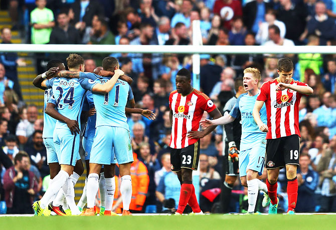Manchester City players celebrate after Paddy McNair of Sunderland scored a own goal to score Manchester City's second goal