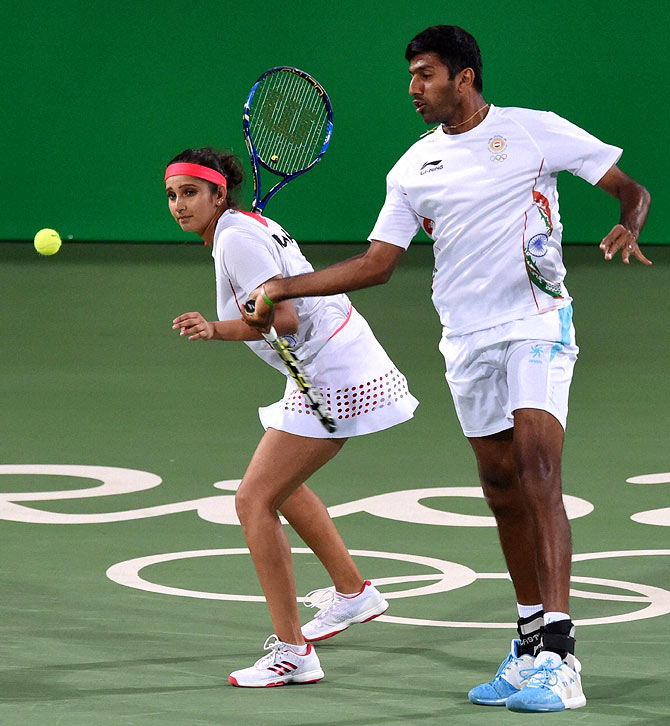 India's Sania Mirza, (left) and Rohan Bopanna in action in their mixed doubles semi-final at the 2016 Rio Olympic Games