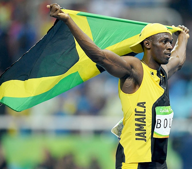 Usain Bolt of Jamaica celebrates winning the Men's 100 meter final on Day 9 of the Rio 2016 Olympic Games