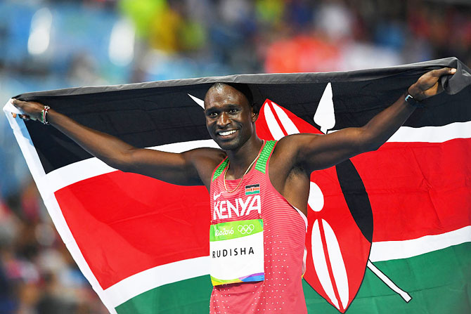 David Lekuta Rudisha celebrates with the Kenyan flag after winning the gold medal in the Men's 800m Final on Monday
