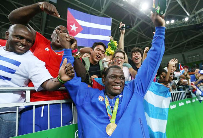 Mijain Lopez of Cuba celebrates with supporters after winning the gold medal in the Men's Greco-Roman 130 kg event on Monday