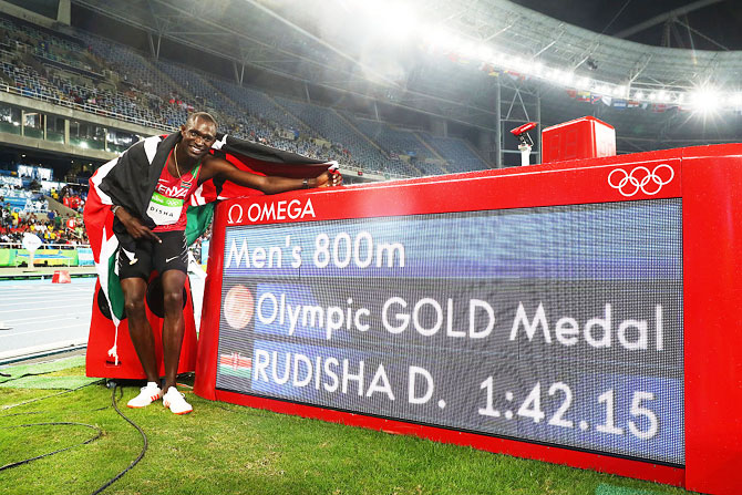 David Lekuta Rudisha of Kenya poses after winning the gold medal in the Men's 800m Final on Day 10 of the Rio 2016 Olympic Games at the Olympic Stadium on Monday