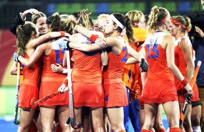 Netherlands women's hockey team celebrate their quarter-final win over Argentina at the Rio Olympics on Monday