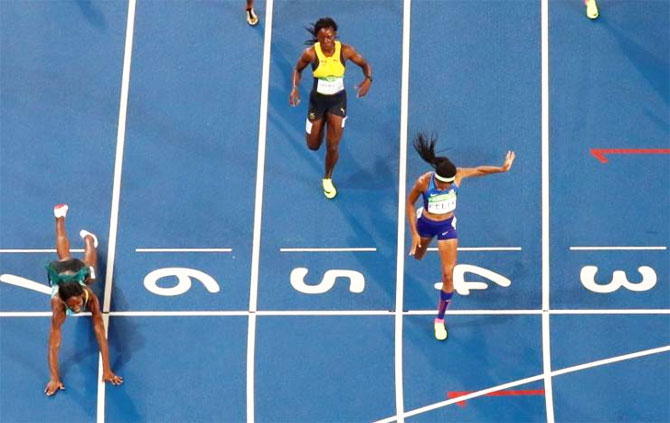 Shaunae Miller of the Bahamas throws herself across the finish line to win the gold in the women's 400m final of the 2016 Rio Olympics at the Olympic Stadium on August 15
