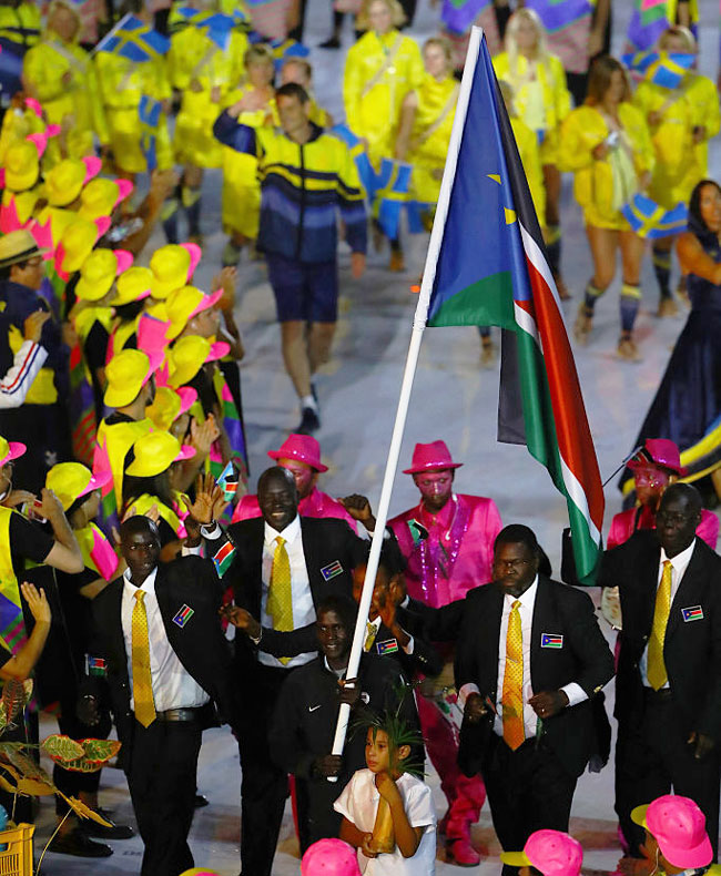 Flag bearer Guor Marial of South Sudan leads his team during the Opening Ceremony of the Rio 2016 Olympic Games at Maracana Stadium in Rio de Janeiro on August 5