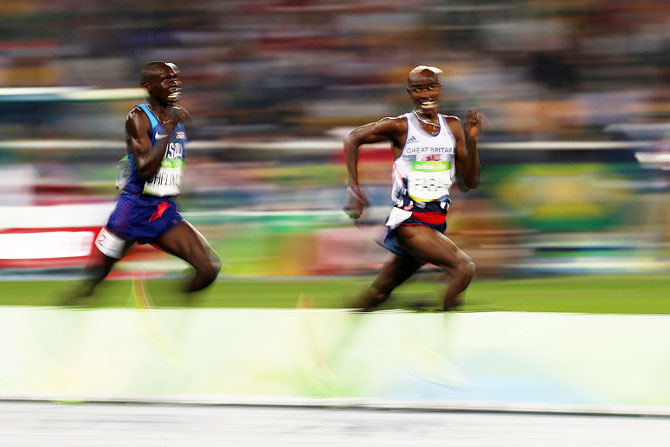 Mo Farah of Great Britain and Paul Kipkemoi Chelimo of the United States compete during the Men's 5000m final on August 20