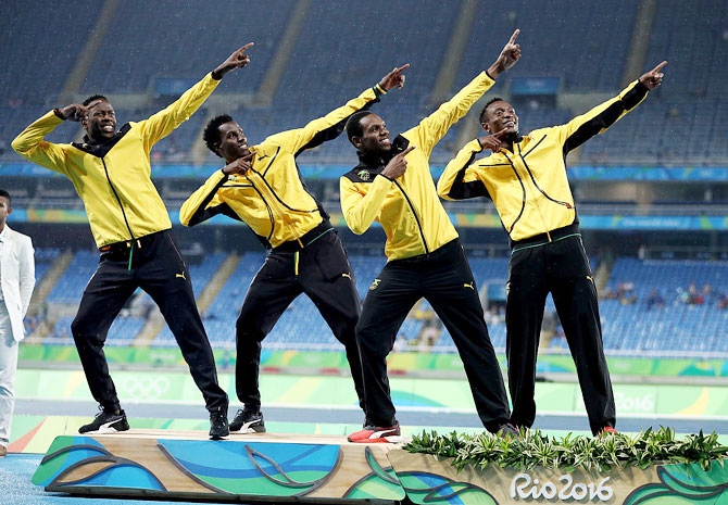 Silver medalists Peter Matthews, Javon Francis, Naton Allen and Fitzroy Dunkley of Jamaica stand on the podium during the medal ceremony for the Men's 4 x 400 meter Relay