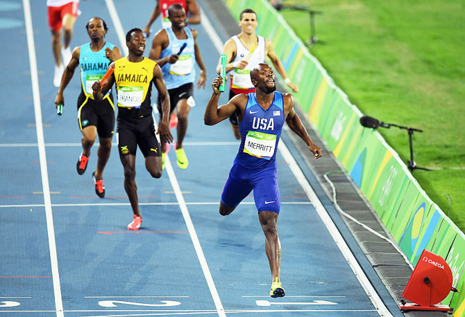 USA's Lashawn Merritt reacts after winning gold in the Men's 4 x 400 meter relay at the Rio 2016 Olympic Games at the Olympic Stadium in Rio de Janeiro on Sunday