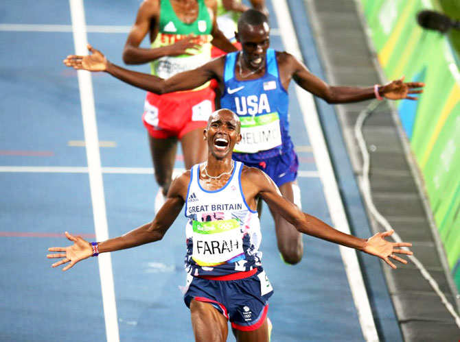 Mo Farah of Britain celebrates winning the 5000m race at Olympic Stadium on August 20