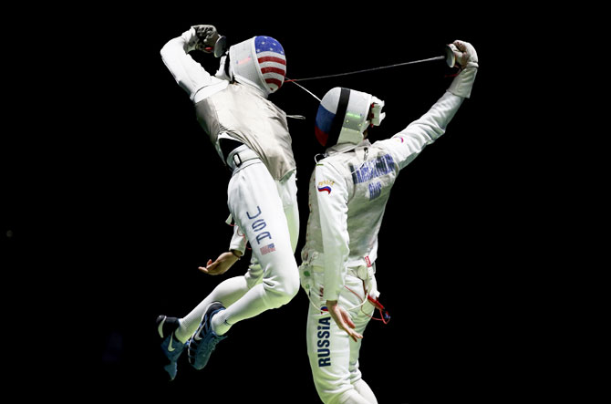 Miles Gerek Meinhardt of USA competes with Artur Akhmatkhuzin  of Russia during the fencing men's foil team semi-final at Carioca Arena on August 12