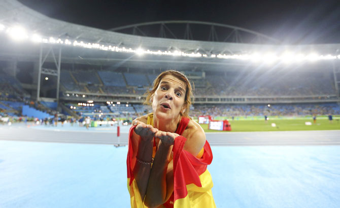 Ruth Beitia of Spain celebrates winning gold in the high jump on August 20