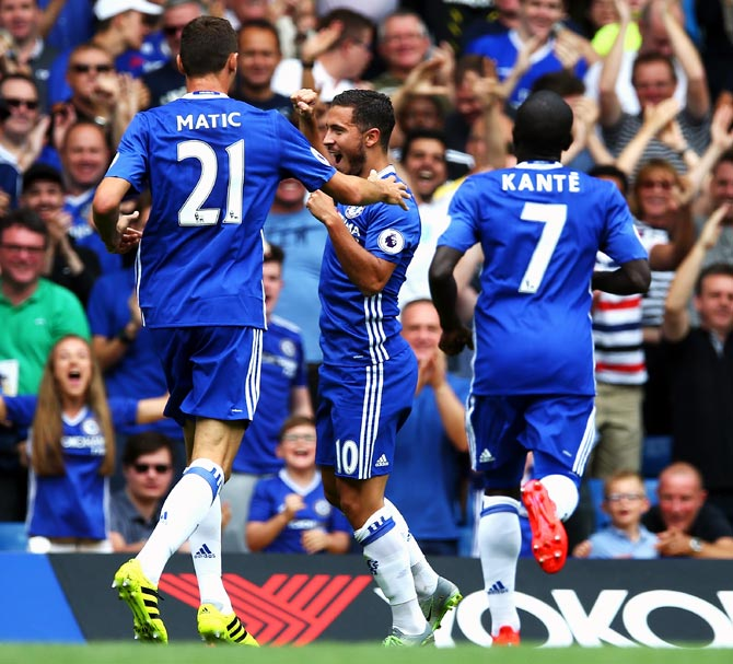 Eden Hazard, centre, celebrates with his team mates after scoring Chelsea's opening goal